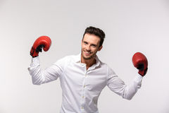 Businessman wearing in red boxing gloves Stock Image
