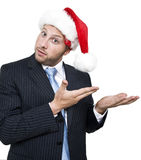 Businessman wearing santa cap stock photo