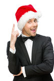 Businessman wearing Santa Claus cap attention gestures royalty free stock images