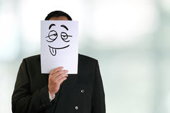 Businessman Wearing Silly Face Mask Stock Photography