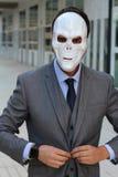 Businessman wearing a skeleton mask royalty free stock image