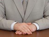 Businessman wearing suit with hands clasped Royalty Free Stock Image
