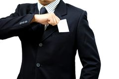Businessman wearing a suit holding a blank card royalty free stock images