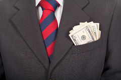Businessman wearing suit with money in the pocket Stock Images