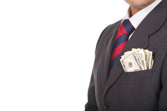 Businessman wearing suit with money in the pocket Stock Image