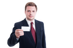 Businessman wearing suit and showing blank empty business card Royalty Free Stock Image