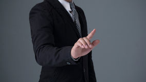 Businessman wearing  suite pointing finger Royalty Free Stock Image