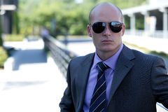Businessman wearing sunglasses Stock Image