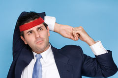 Businessman wearing a sweatband royalty free stock images