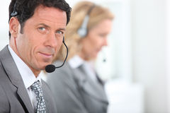 Businessman wearing a telephone headset Royalty Free Stock Photos