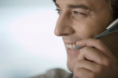 Businessman wearing telephone headset, smiling, close-up Royalty Free Stock Image