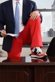 Businessman wearing tracksuit bottoms stock image