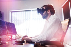 Businessman wearing virtual glasses. In a office Royalty Free Stock Images