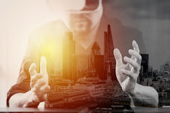 Businessman wearing virtual reality goggles in modern office wit Royalty Free Stock Photos