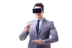 The businessman wearing virtual reality vr glasses isolated on white. Businessman wearing virtual reality VR glasses isolated on white Stock Photography