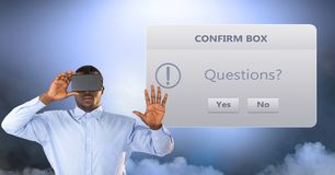 Businessman wearing VR glasses by confirm box. Digital composite of Businessman wearing VR glasses by confirm box Royalty Free Stock Image
