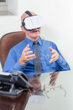 Businessman wearing VR headset, amazed Stock Image