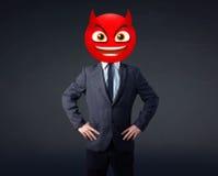 Businessman wears devil smiley face Stock Photography