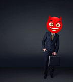 Businessman wears devil smiley face Royalty Free Stock Images