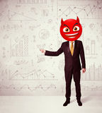 Businessman wears devil smiley face Stock Image