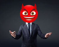 Businessman wears devil smiley face Royalty Free Stock Photos