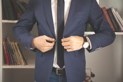 Businessman wears a jacket royalty free stock image