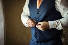Businessman wears a jacket.Politician, man`s style,male hands cl. Oseup, American, European businessman, business, fashion and clothing concept Royalty Free Stock Photos