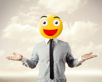 Businessman wears yellow smiley face Stock Photo