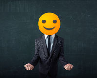 Businessman wears yellow smiley face Royalty Free Stock Image