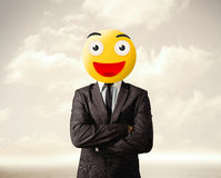 Businessman wears yellow smiley face Royalty Free Stock Images