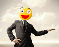 Businessman wears yellow smiley face Stock Photography