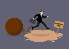 Businessman with the weight jumping over the quicksand Royalty Free Stock Image