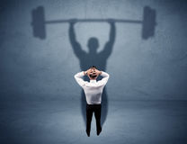Businessman with weight lifting shadow Royalty Free Stock Images