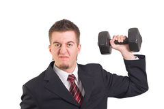 Businessman is weightlifting Stock Images