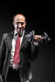 Businessman and weights Stock Photo