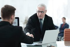 Businessman welcomes business partner shaking hands Royalty Free Stock Photography