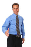 Businessman welcoming with extended hand. Against a white background Stock Image