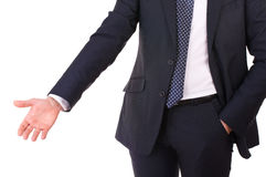 Business man with welcoming gesture. Stock Photo