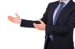 Businessman with welcoming gesture. Stock Photo