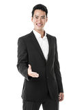 Businessman welcoming with a handshake Stock Images