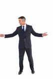 Businessman well dressed spreading his arms Royalty Free Stock Photos