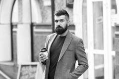 Businessman well groomed appearance enjoy coffee break out of business center. Relax and recharge. Man bearded hipster. Drinking coffee paper cup. One more sip stock photo