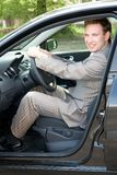 Businessman at the wheel Royalty Free Stock Photography