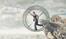 Businessman in wheel Royalty Free Stock Images