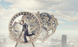 Businessman in wheel Royalty Free Stock Photos
