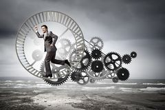 Businessman in wheel Stock Photos