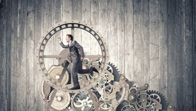 Businessman in wheel Stock Photos