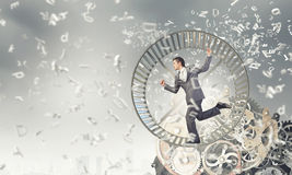 Businessman in wheel Stock Images