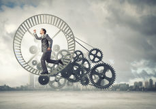 Businessman in wheel Stock Photo