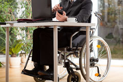 Businessman on wheelchair Royalty Free Stock Photos